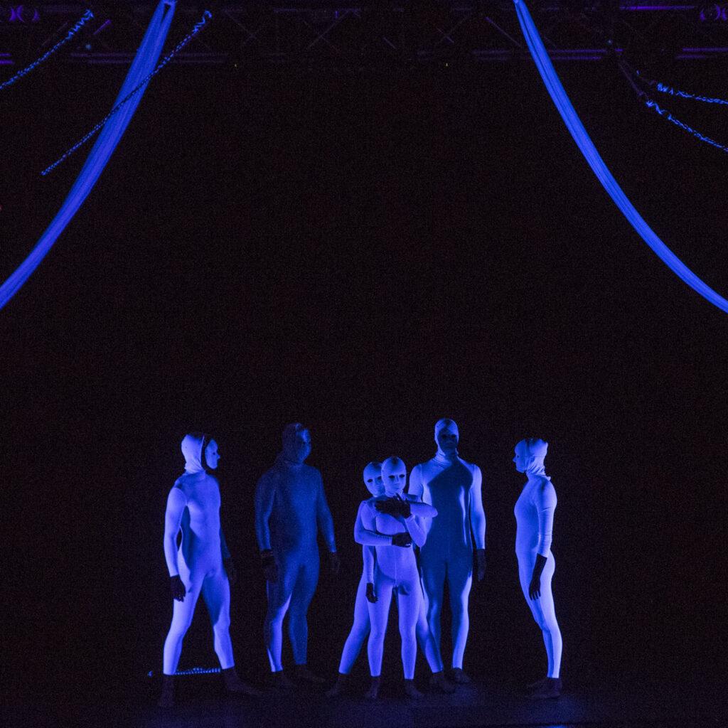 Identity taken blacklight circus show